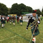 The Peterborough Highland Pipe Band leading the procession